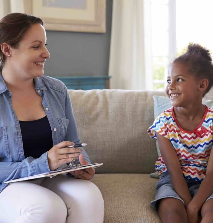 Young Girl Talking With Counselor At Home