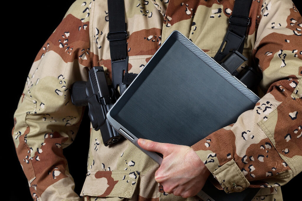 military holding laptop