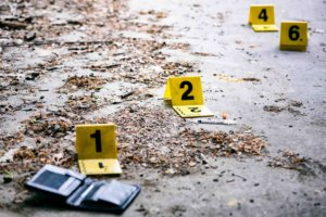Crime investigation, yellow marker on the ground