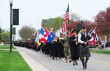 TU commencement walk led by bagpipes and flag holders